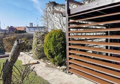 Przeciwsłoneczna osłona ściany lub dachu